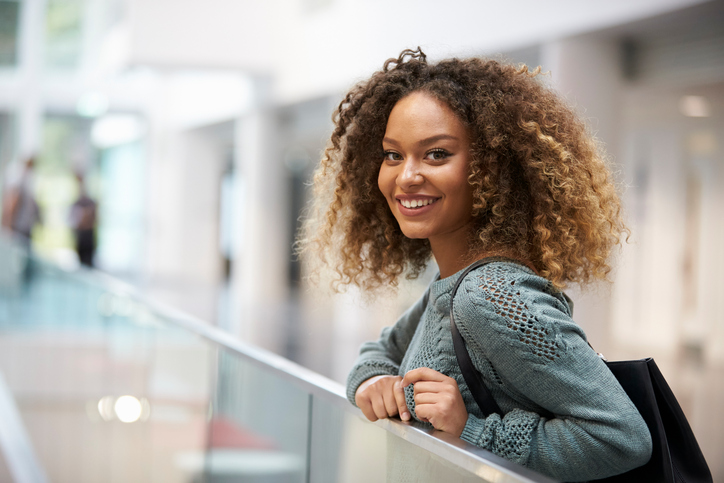 Smiling mixed race young woman looking to camera